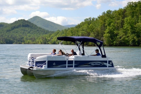 People sitting on a pontoon charter boat